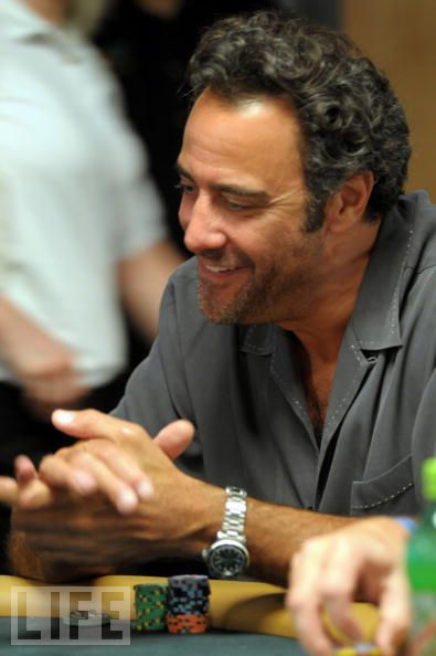 Brad Garrett playing poker